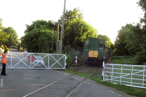 Departing Shepherdswell and over the manually operated level crossing across Eythorne Road