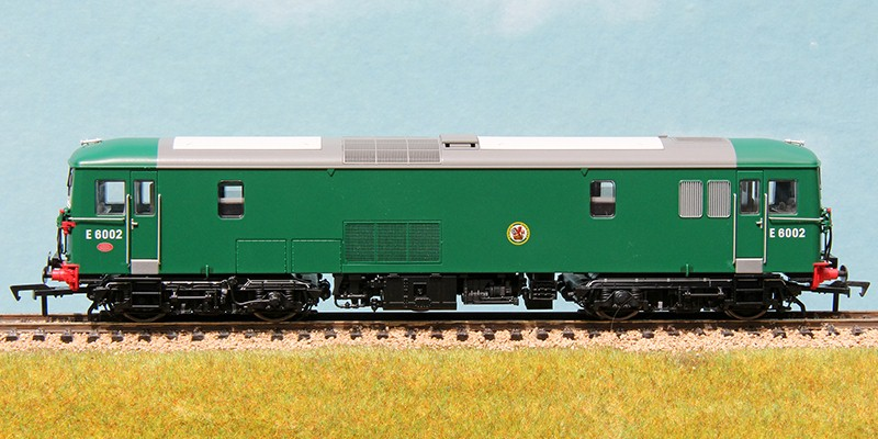 Three quarter view of JA E6002 in BR(S) coach green and with oval buffers. Dapol 4D-006-014