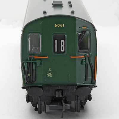 The cab front of unit 6061 in BR green showing a headcode of 18