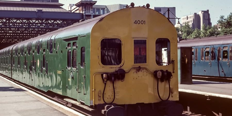 Bulleid 4DD unit 4001 in green livery with full yellow warning panel at Charing Cross